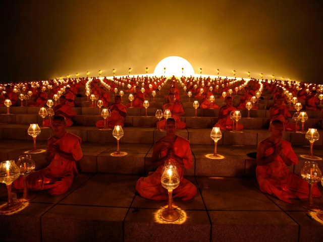 Thousands of Buddhist monks chant during a lantern lighting to celebrate Makha Bucha day